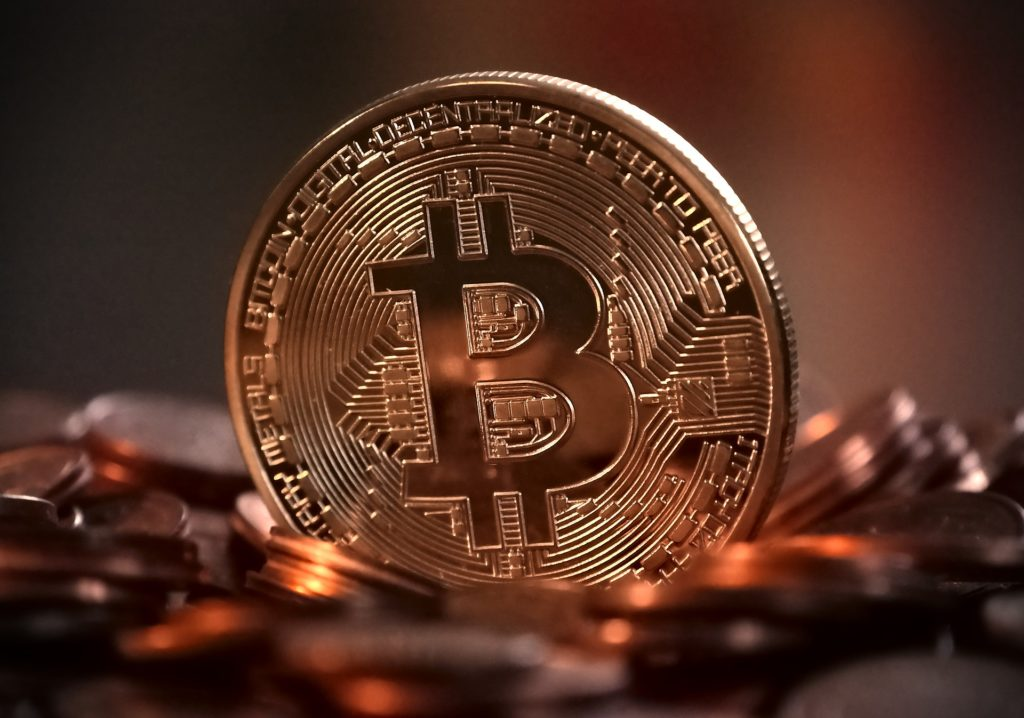 Picture of a Coin With BTC Logo
